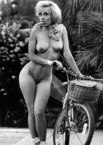 Linnea Quigley full frontal nude with bicycle - vintage porn photo