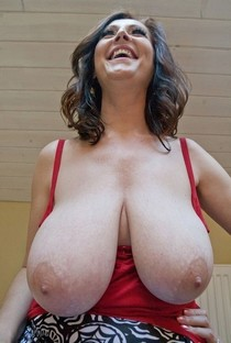 Mature Cherry of OMG Big Boobs shows her heavy hangers.
