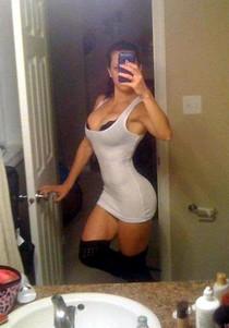 Naughty bimbo selfshot her big ass and big natural tits in sexy dress