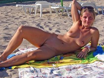 Horny blonde pure mature nudist with small tits and shaved horny pussy enjoy on beach