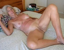 Granny fully naked on her bed waiting for some good'ol cock..