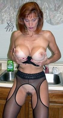 Huge Titted Milf Jenn Loves Cum holds her bolt on tits.