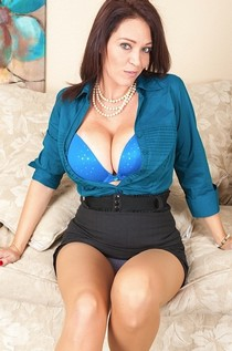 MILF Charlee Chase teases with that cleavage.