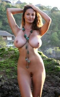 Petra Verkaik's huge natural brunette tits in the sunset.