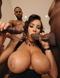 Busty babe entertains two huge black Cocks..