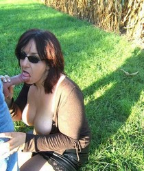 Mature brunette giving head! Wild oral sex outdoors!