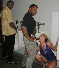 Amateur slut wife sucks a black cock in public restroom.