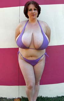 Mature In purple bikini with large udders.