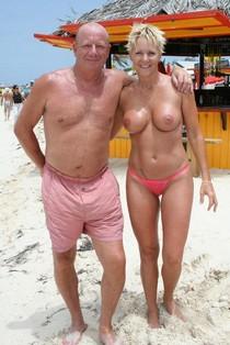 Busty mom on the beach