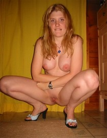 Sexy blonde spreading legs and showing nice tits and pussy