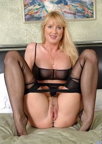Superb blonde stockings in amazing pussy photo.