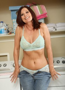Cool mature redhead Caroline naked in the home laundry