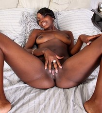 Nice ebony showing her wet shave juicy pussy and nude wonderful hot breasts
