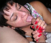Older woman licking lover's cock