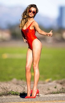 Leggy Courtney Sixx in red tight swimsuit