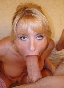 Blue eyed blonde with mouth full of cock.