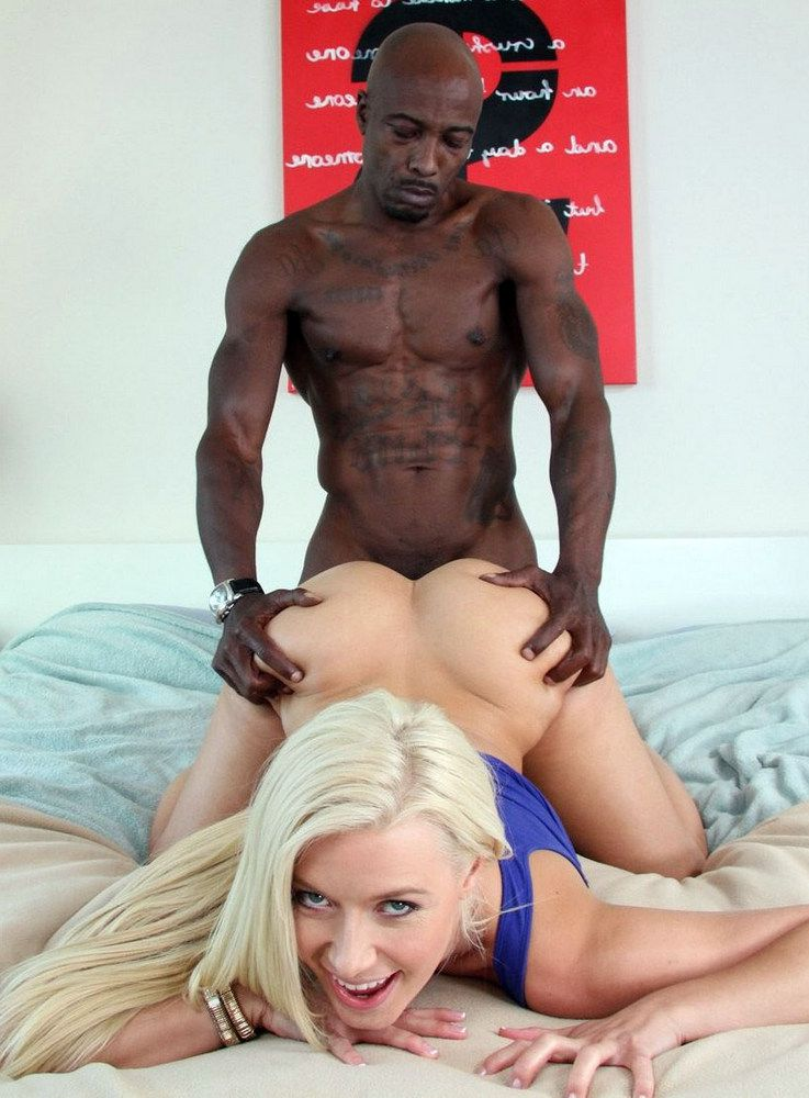 A muscular black guy fucks a blonde from behind